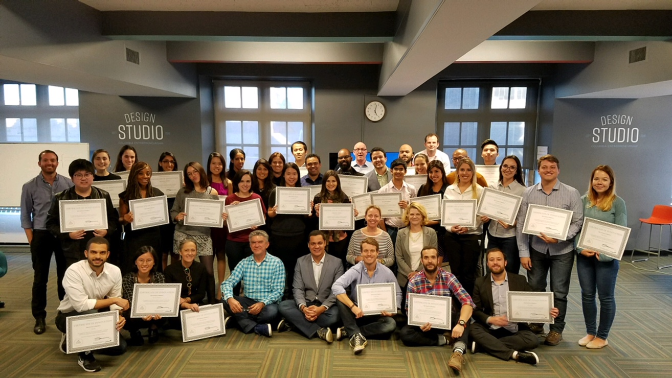 Design Sprint group shot of the cohort and their Certificates of Innovation