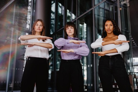 WomenGesturingEqualSign